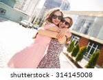 two girls friends laughing and... | Shutterstock . vector #314145008