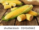 Fresh Corn On Cobs On Rustic...