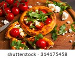 tasty mini pizza with tomatoes... | Shutterstock . vector #314175458