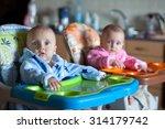 two children in robes in high... | Shutterstock . vector #314179742