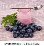 yogurt and blueberries on pink... | Shutterstock . vector #314184602