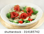 arugula salad with raw beef... | Shutterstock . vector #314185742