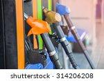 gas pump nozzles in a service... | Shutterstock . vector #314206208