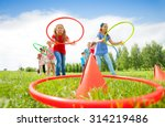 Kids Throw Colorful Hoops On...