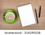 blank notepad and coffee cup on ... | Shutterstock . vector #314290538