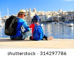 father and son looking at city... | Shutterstock . vector #314297786