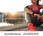 Young Woman Runner Resting...