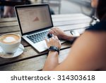 cropped shot of a woman at cafe ... | Shutterstock . vector #314303618
