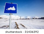 A Snowmobile Trail Sign In...