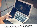 hand woman using smart phone... | Shutterstock . vector #314380376
