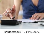 close up of female accountant... | Shutterstock . vector #314438072