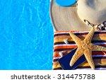beach hat  bath towels  cell... | Shutterstock . vector #314475788