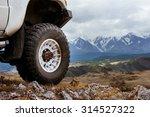 big car wheel is standing on... | Shutterstock . vector #314527322