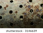 An old badly rusted and corroded perforated steel cylinder - stock photo