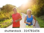 Small photo of Active seniors running outside in green nature
