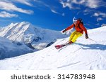 Skier Skiing Downhill In High...