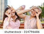 two cheerful girls fooling... | Shutterstock . vector #314796686