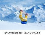 legs of a snowboarder stuck in... | Shutterstock . vector #314799155
