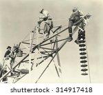 men working on power lines | Shutterstock . vector #314917418