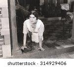 Woman Scrubbing The Floor