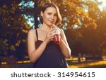 beautiful young girl is... | Shutterstock . vector #314954615