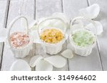Stock photo sea salt in wicker baskets among white rose petals 314964602