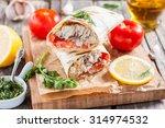 fish in bread  in a pita.... | Shutterstock . vector #314974532