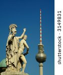 marble statue and tv-tower in central berlin - stock photo