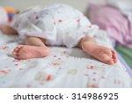 closeup baby feet on blanket | Shutterstock . vector #314986925