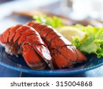 lobster dinner with lemon and... | Shutterstock . vector #315004868
