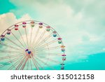 ferris wheel on cloudy sky... | Shutterstock . vector #315012158