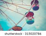 ferris wheel on cloudy sky... | Shutterstock . vector #315020786