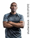 Small photo of Sportsman with arms crossed standing against white background