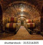 rows of oak barrels in... | Shutterstock . vector #315216305