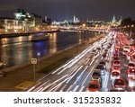 Night Traffic Along A City River