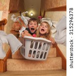 two young children are riding... | Shutterstock . vector #315296378