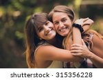 two sisters hugging each other...   Shutterstock . vector #315356228