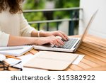 side view of woman working on... | Shutterstock . vector #315382922