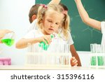 cute pupils doing biochemistry... | Shutterstock . vector #315396116