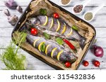 two raw trouts fish on the... | Shutterstock . vector #315432836