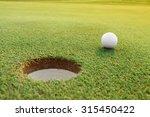 golf ball on the pure green... | Shutterstock . vector #315450422