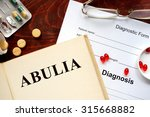 Small photo of Abulia written on book with tablets. Medicine concept.