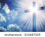 The cross with bright sun and...
