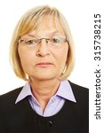Stock photo neutral face of old woman with glasses for biometric passport photo 315738215