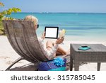 Woman Using Digital Tablet On...