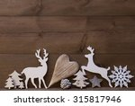 Small photo of Wooden Background With Many Christmas Decoration.Heart, Snowfalke, Fir Cone, Christmas Tree, Star, Reindeer. Copy Space, Free Text Or Your Text Here. Rustic Or Vintage Style