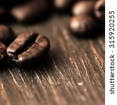 coffee beans on wooden table | Shutterstock . vector #315920255