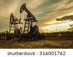 oil pump jacks at sunset sky...   Shutterstock . vector #316001762