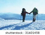 Couple in winter mountains - stock photo