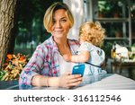 young beautiful mother with her ... | Shutterstock . vector #316112546